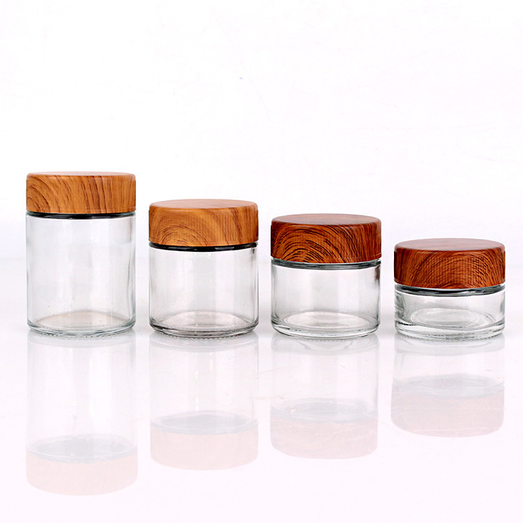 Hot Sale 40ml 80ml 90ml 110ml round clear child proof glass jar with bamboo lids Featured Image