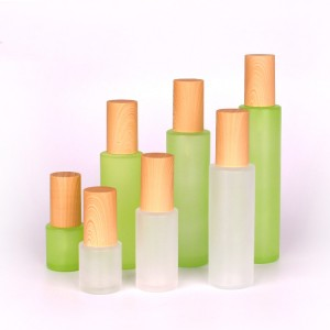 set of cosmetic packing glass round bottles with pump press lid